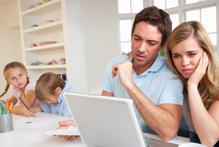 Worried parents looking over finances