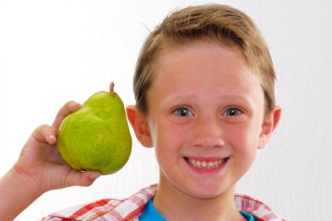 Boy eating pear