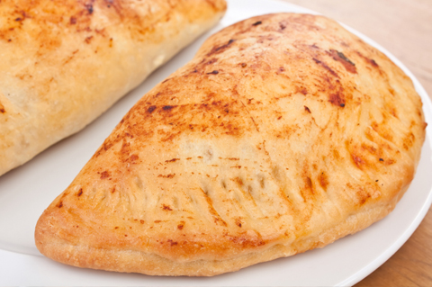 Spinach, sausage and three cheese calzone