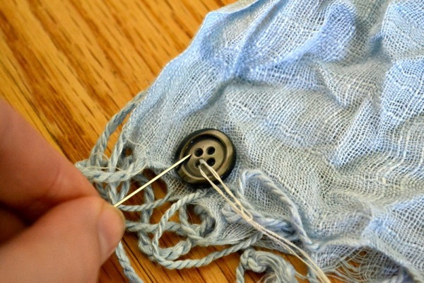 Upcycle a regular scarf into an infinity one with buttons!
