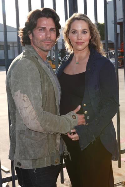 Pregnant Elizabeth Berkley and husband