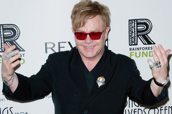 Elton John hospitalized, cancels shows