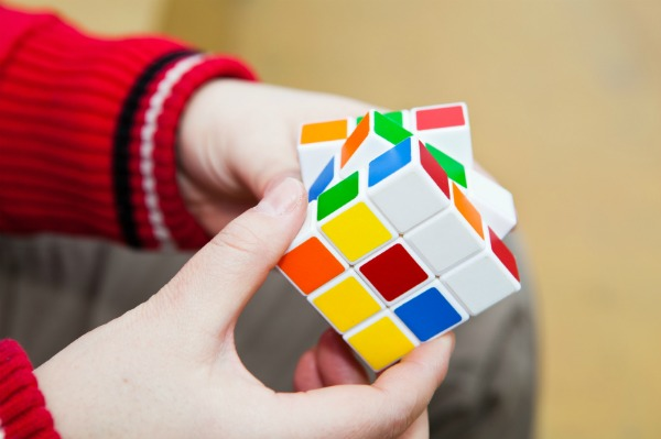 Child playing with Rubix cube