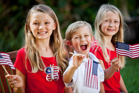 Kids with memorial day flags