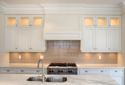 Kitchen with white painted cabinets