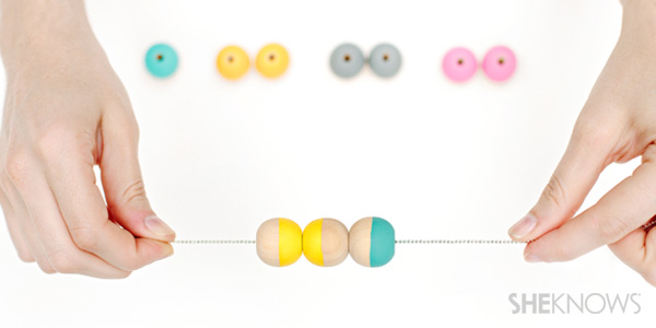DIY necklace tutorial: line up the next painted bead color on the necklace