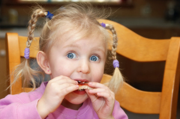 Little girl eating a snack