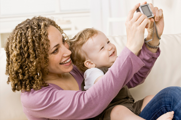 mom and child with digital camera