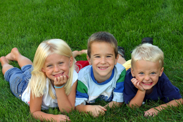 Kids playing in the grass in the summer