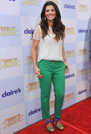 Ali Landry wearing green jeans