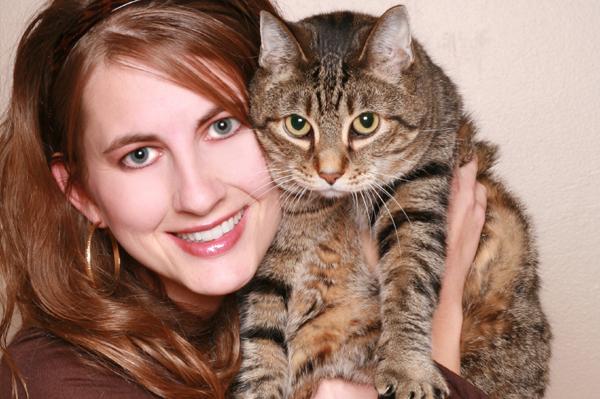 woman cuddling cat