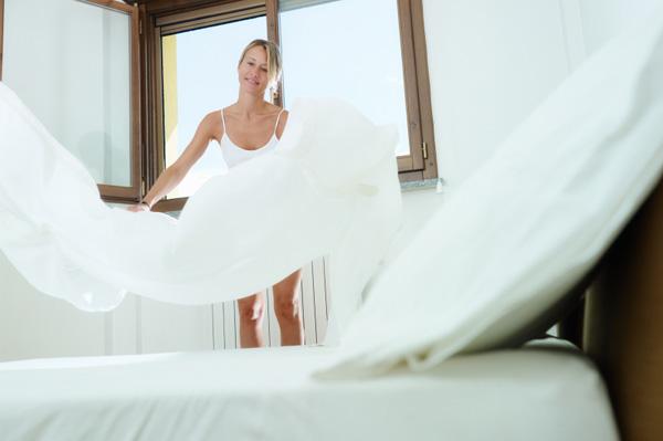 Woman changing organic sheets