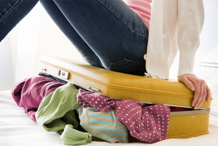 Woman with overstuffed luggage