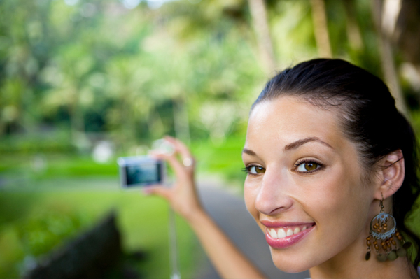 woman with digital camera on vacation