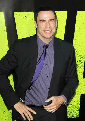 Actor John Travolta Attends Savages Premiere