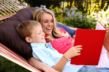mom and son reading in hammock