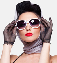 Woman wearing scarf and sunglasses