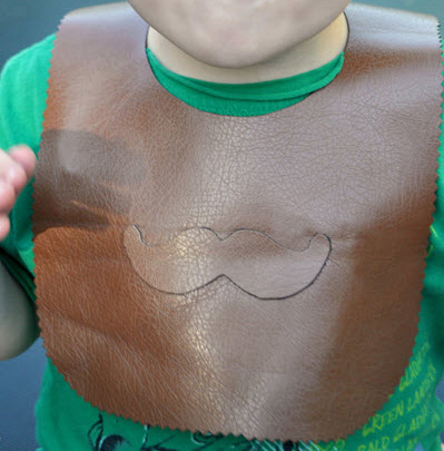 Baby wearing moustache bib