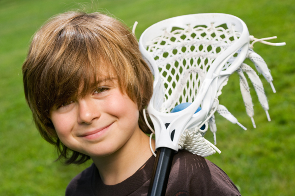 happy, healthy boy playing lacrosse