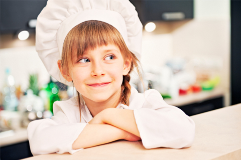 Little girl wearing chef hat
