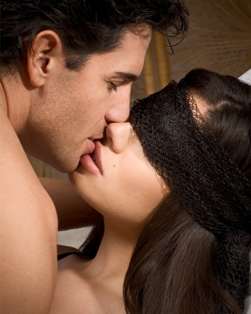 Couple kissing with blindfold on