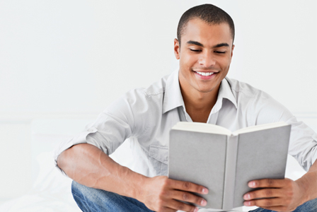 Cute guy reading a book