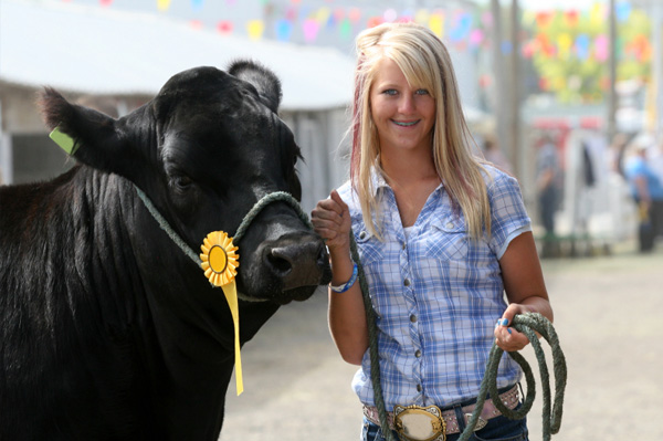 Girl with steer at county fair