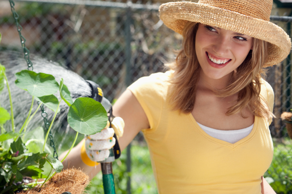 Happy woman with herb garden
