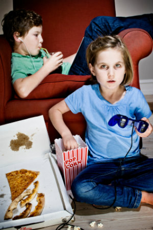 Kids playing video games and eating junk food