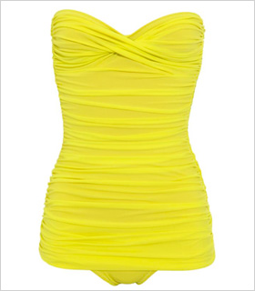 Norma Kamali Walter Mio Ruched Bandeau swimsuit, $448, brownsfashion.com.