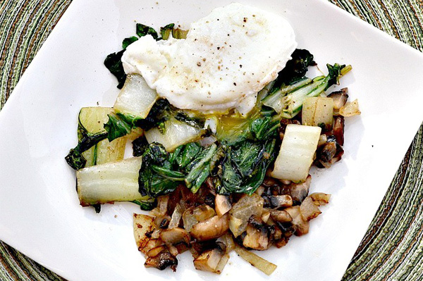 Poached egg served over bok choy