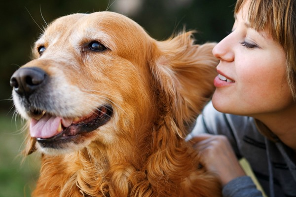 woman loving her dog