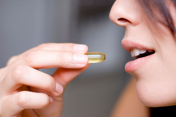 Woman taking a vitamin