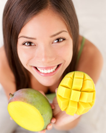 Woman with mangos