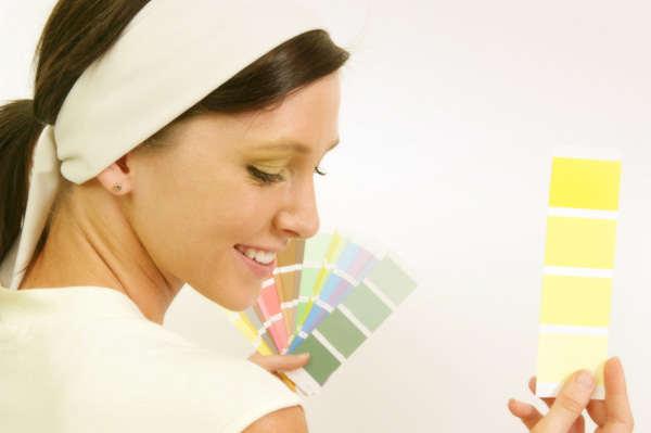 woman picking paint color