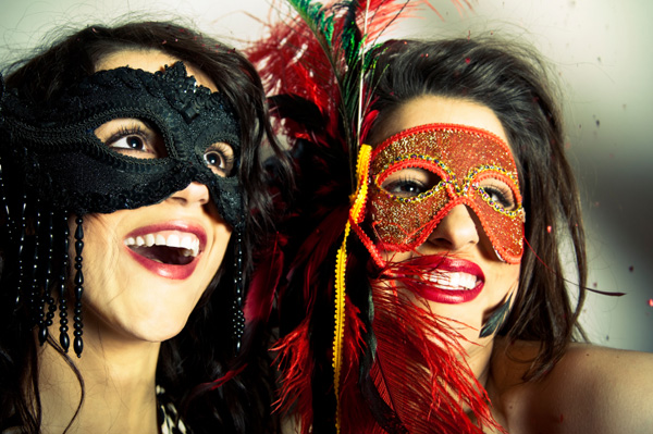 women at mardi gras themed party