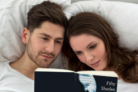 Couple reading 50 Shades of Grey