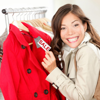 Woman buying thrift store jacket