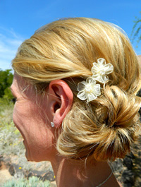Ivory flower in bride's hair