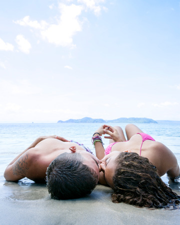 Couple on beach having sex