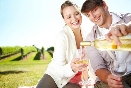 Woman having wine outdoors