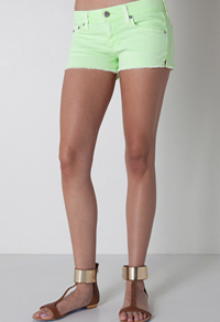 Neon green denim shorts by AG Jeans