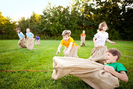 Kids having potato sack race