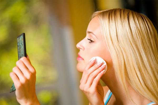 Mom applying makeup