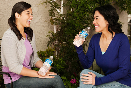 Mom and daughter drinking water