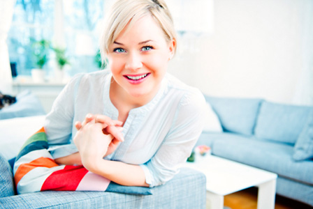Trendy woman in stylish living room