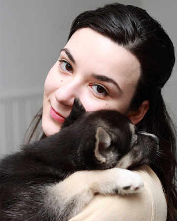 Woman hugging husky