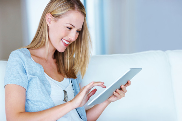 Woman on iPad planning weddng