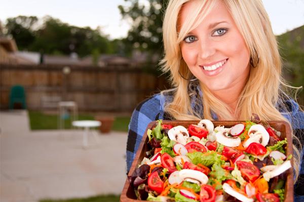 Woman with a big salad