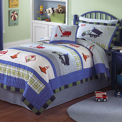 construction themed bedroom with construction truck wall paper and